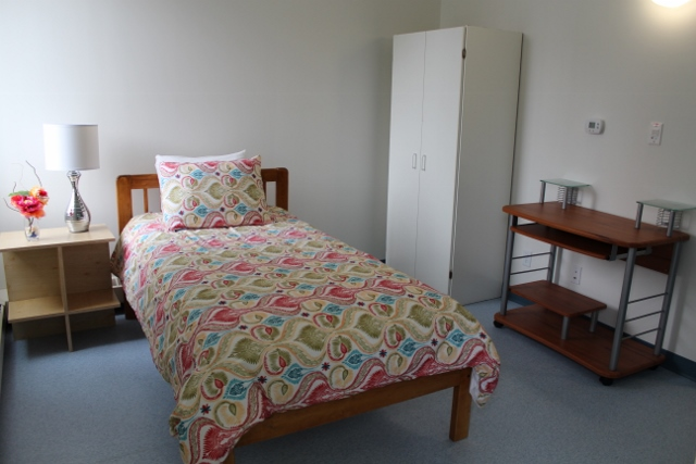 All bedrooms at the House of Peace come with a bed, wardrobe, and private bathroom.