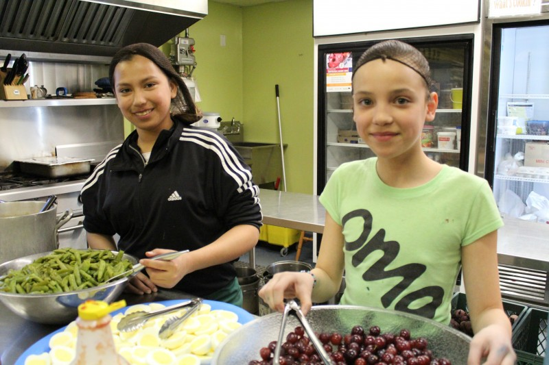 Chelsea McCallum and Shay Harris enjoy volunteering in the kitchen at Inner City Youth Alive.