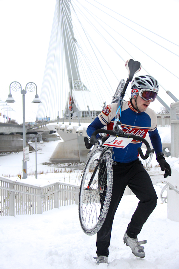 One of Icebike's racers climbing the steps by Riel Esplanade