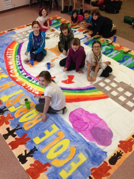 Adventure Club students from Robert H. Smith School prepare banner for Community Breakfast