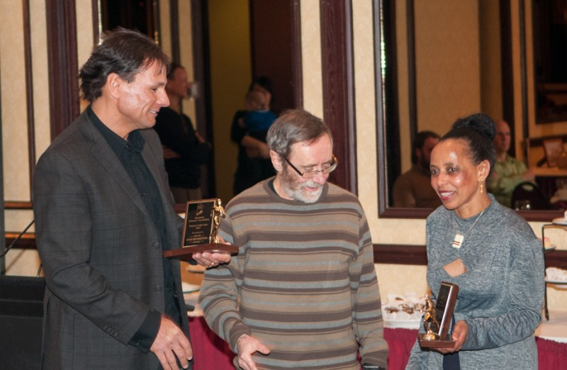 Don Bevington and Ami Samel being presented the Male and Female Runners of the Year by Jeff Vince