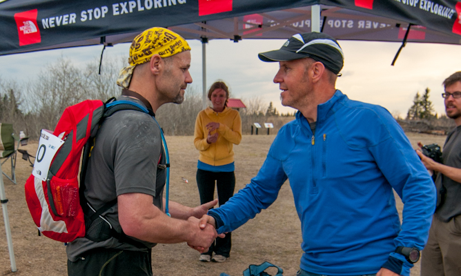 Jeff Bond dug deep for his 50 mile medal and is given a respectful handshake from Dwayne Sandall