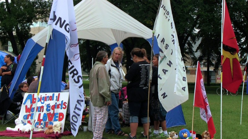 Winnipeg, August 24, 2014: Some of the people camping in Memorial Park to call for a national inquiry into missing and murdered aboriginal women in Canada. Photo: Paul S. Graham
