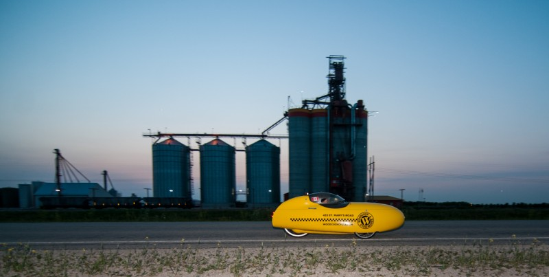 Kevin Champagne flying by the huge grain elevator near Brunkild Manitoba