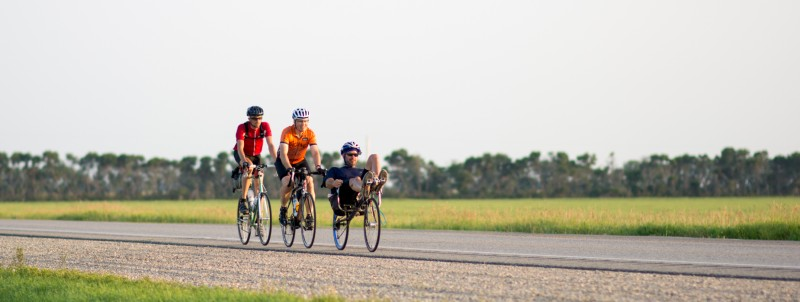 from l to r, Sam Ehlers, Mark Gray and Pete McAdam on the recumbent during their 1000 kilometer Brevet across Manitoba