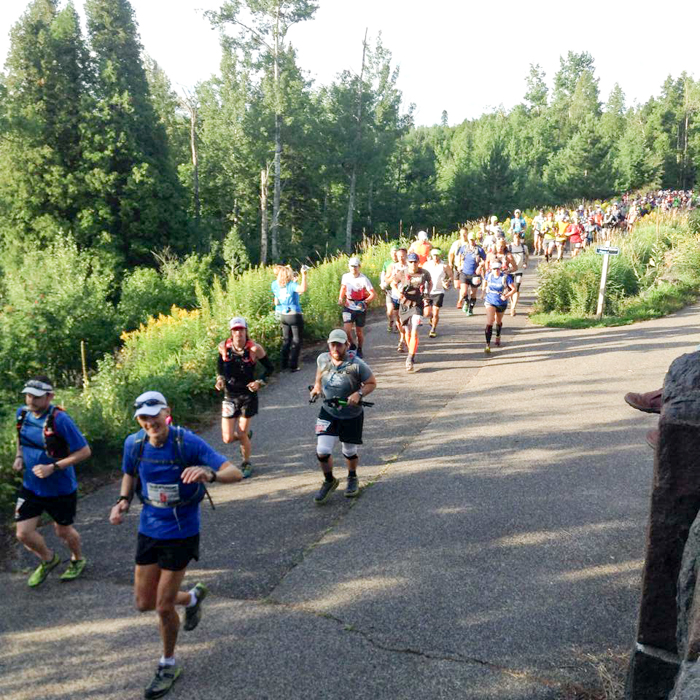 Many runners starting off the 2014 Superior 100 Mile Trail Race held in Northern Minnesota