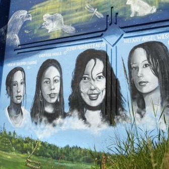 A  mural on the rail bridge over Portage Ave. depicts murdered Manitoba Aboriginal women.