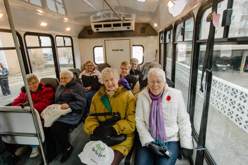 Passengers on the Wheels to Meals shuttle, a free service that ensures seniors can get a healthy meal and meet friends. Photo credit: Ian McCausland for The Winnipeg Foundation.