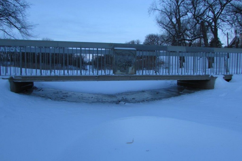 The bridge at Omands Creek where thin ice is clearly visible.