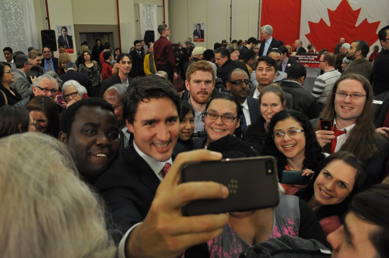 Mr. Trudeau played the photographer as he snapped selfies with peoples cameras