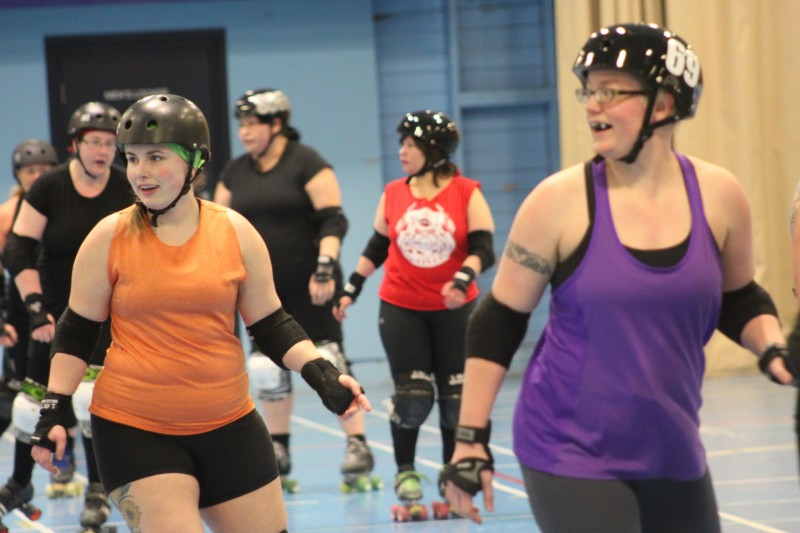Kaylon Mullen (left) loves the competitive aspect roller derby provides.