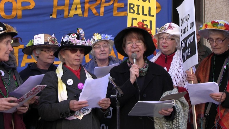 March 14, 2015: The Raging Grannies performed at a rally held at Winnipeg City Hall to protest Bill C-51 (The Anti-Terrorism Act), introduced by the federal Conservative government  on January 30, 2015. Photo: Paul S. Graham