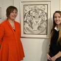 Balmoral Hall visual arts teacher Kristina Karlsson (left) with grade 12 student Sarah Gage, who created this drawing of a tiger using pointillism. Photo by Jennifer Pawluk