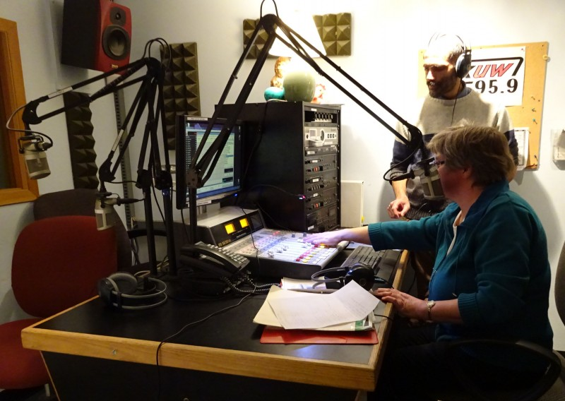 Michael Welch shows Susan Huebert the ropes at CKUW control board