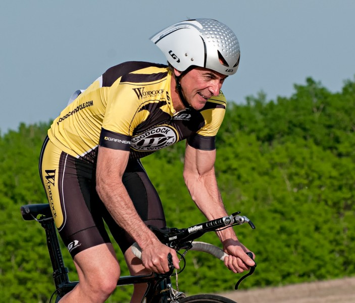 Local cycling star Don Sawatzki tries to keep a smile while he grinds out the start of his Time Trial