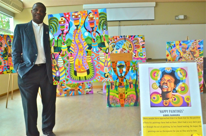 People have called Gibril's artwork 'Happy Paintings'. PHOTO: Doug Kretchmer