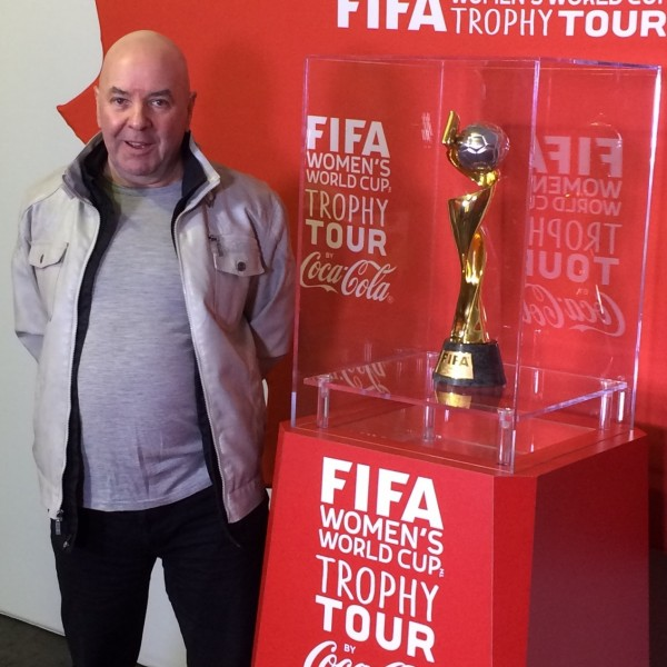 The author poses with the FIFA Women's World Cup on its recent promotional tour across Canada.