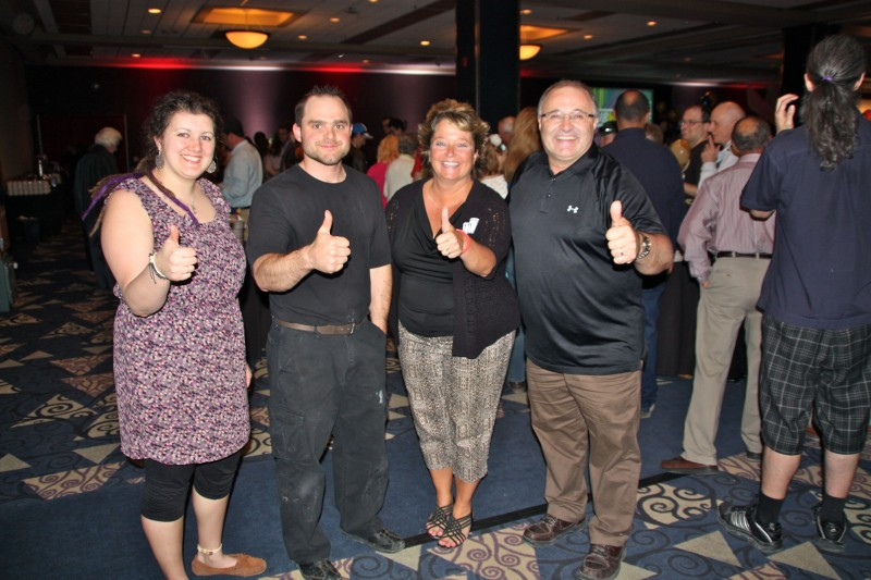 Danny's Whole Hog staff Candice Wollman and Darren Waldner give the thumbs up with Judy Richichi, director of major gifts and corporate relations at Siloam Mission, and Danny Kleinsasser at the 2015 Siloam Mission Volunteer Appreciation Dinner.