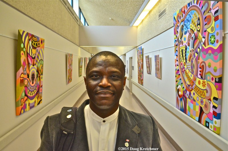 Gibril Bangura is the first artist whose 'happy paintings' will brighten Seven Oaks Hospital's hallway for the next four months. PHOTO:  Doug Kretchmer