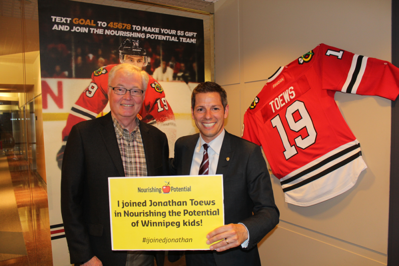 Mayor Brian Bowman (right), with Rick Frost, CEO of The Winnipeg Foundation.