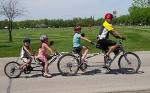 Vinh Huyn cycling with his kids. On Thursday, hear from Vinh and other parents who have incorporated active transportation into their family lifestyle.