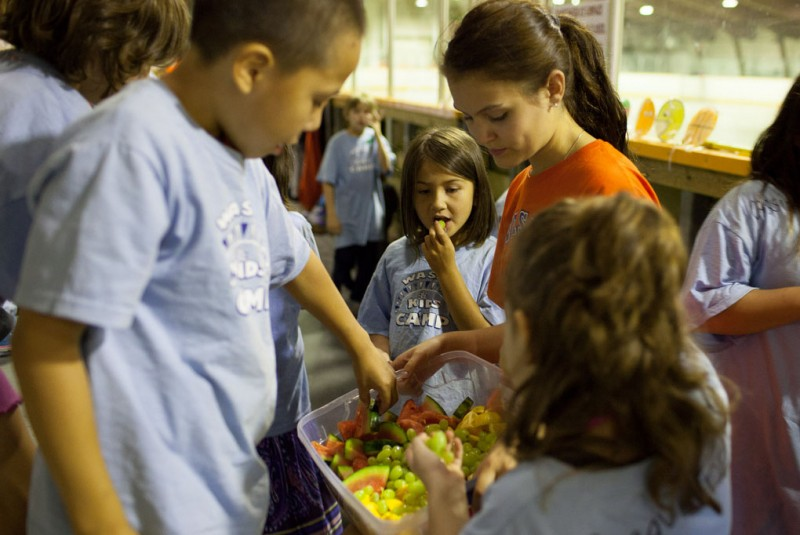 Digging in to healthy snacks at WASAC summer camp.