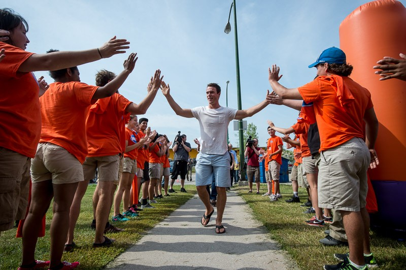 Jonathan Toews is greeted by WASAC youth leaders.