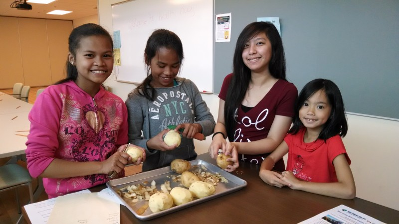 Peeling potatoes, courtesy of NorWest Co-op Community Health Centre.