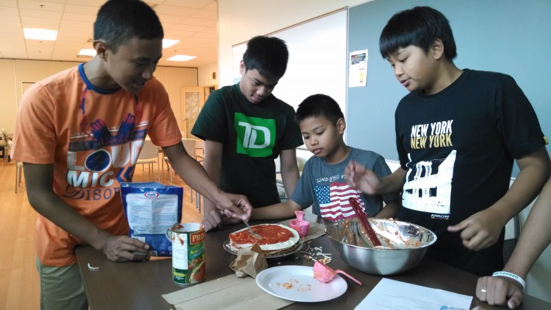 Teamwork in the kitchen, courtesy of NorWest Co-op Community Health Centre.