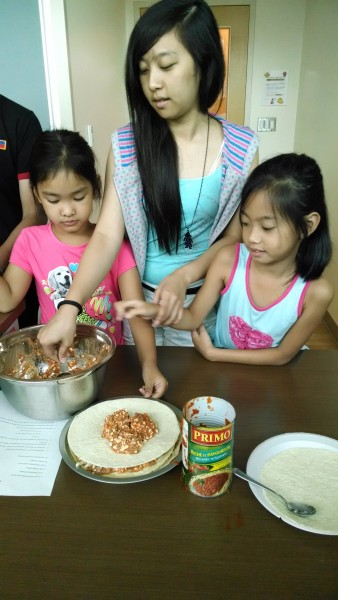 Preparing a meal together, courtesy of NorWest Co-op Community Health Centre.