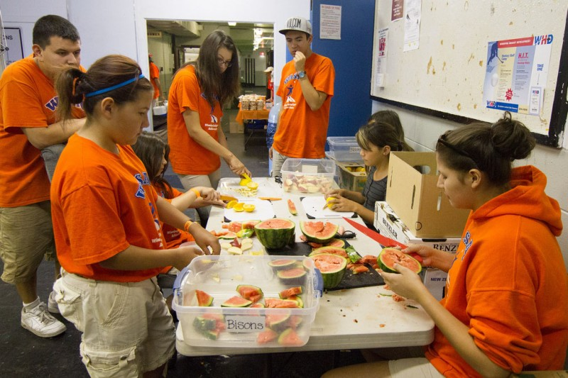 Youth leaders preparing food for WASAC summer camp.