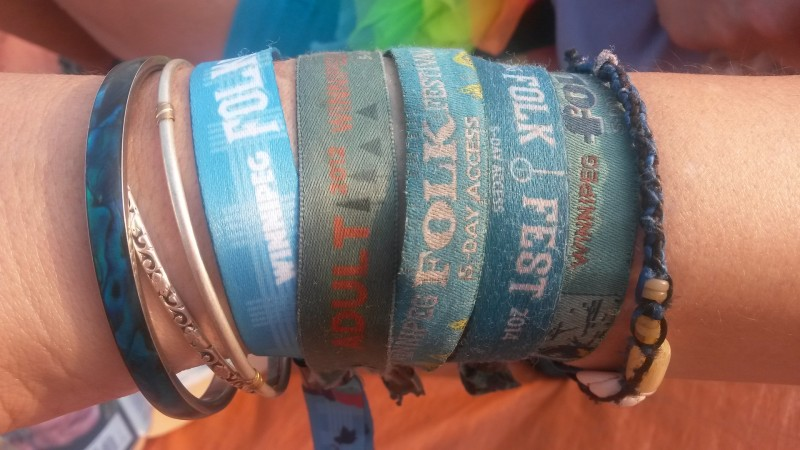 Kim Stephenson's arm is adorned with wristbands from previous Winnipeg Folk Festivals. PHOTO: Cheryl Cohan