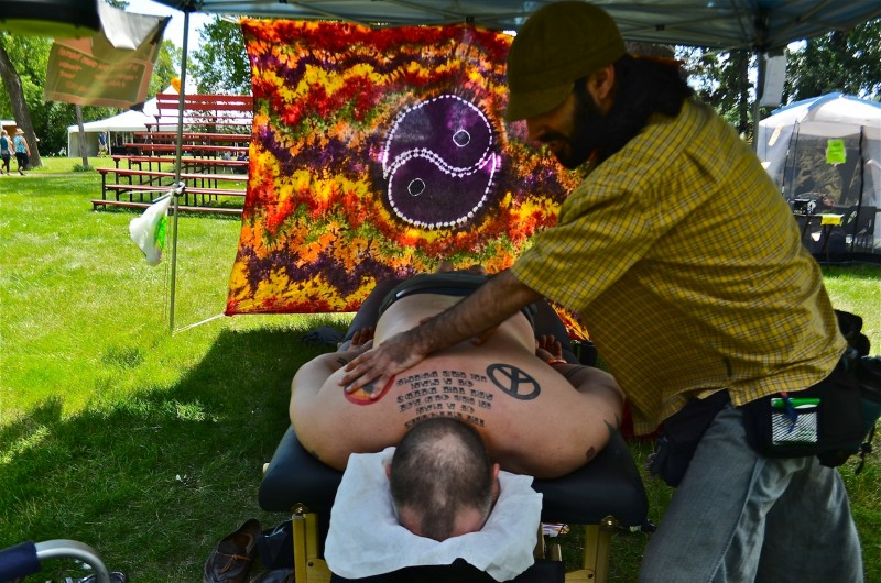 People with aches and pains were helped out with Massage By Myles within earshot of the music