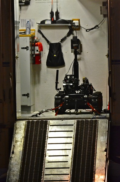 The remote controlled robot back in side the bomb squad truck