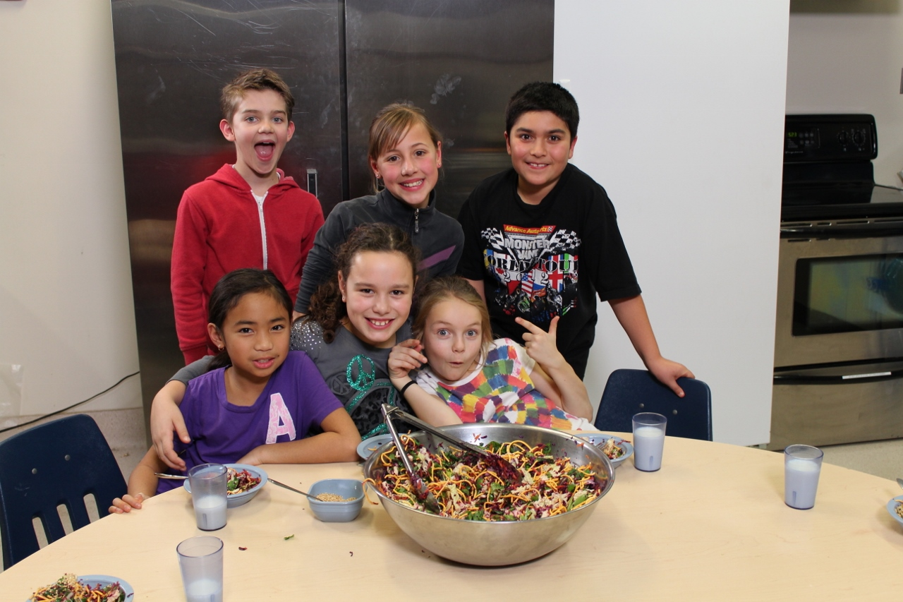 Cooking Club members pose in front of their delicious creation.