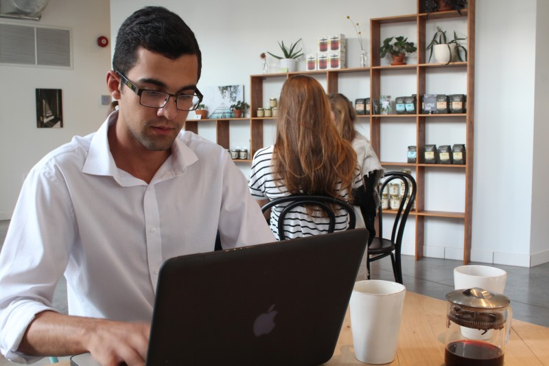 Darius Maharaj-Hunter answers emails at Fools & Horses after a full day at work for the Progressive Conservative Party of Manitoba on Monday, Sept. 14. RED RIVER COLLEGE/Danielle Doiron