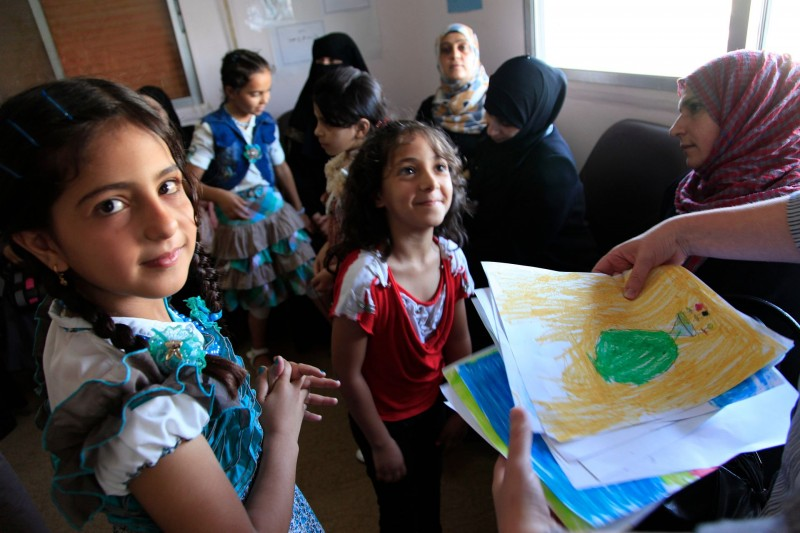 Refugee_children_from_Syria_at_a_clinic_in_Ramtha,_northern_Jordan