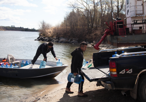 Shoal Lake 40 residents unload safe drinking water from a motorboat after their ferry was deemed unsafe. Their reserve remains under 18-year boil water advisory. PHOTO: David P. Ball, TheTyee.ca
