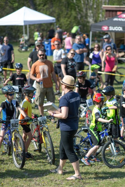 Moni, in blue, is busy organizing a local race at Grand Beach earlier this year