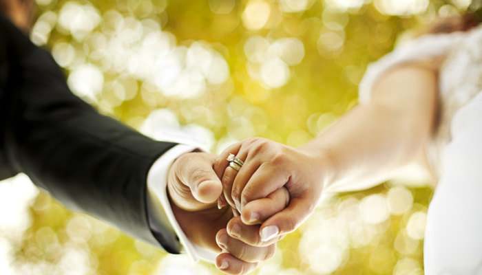 345974-couple-holding-hands