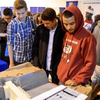 High school students view a model of the Folsom Dam auxiliary spillway, part of the U.S. Army Corps of Engineers Sacramento District display at the GPS Career Fair at Cal Expo in Sacramento, Calif., Sept. 25, 2013. The district hosted a booth at the event to encourage kids to pursue careers in science, technology, engineering and mathematics, or STEM. (U.S. Army photo by Patrick Bray/Released)