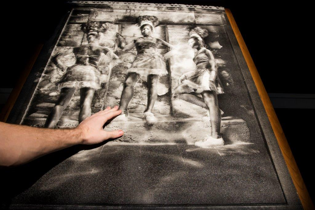 """New technology that creates 3-D, tactile versions of photos is a unique aspect of Sight Unseen at the CMHR. The first museum exhibit in the world to use 3DPhotoWorks imagery, Sight Unseen enables people with vision loss to """"see"""" these powerful images through their fingertips."""