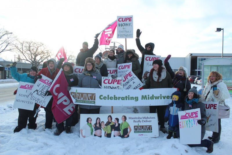 Manitoba midwives greet the public.