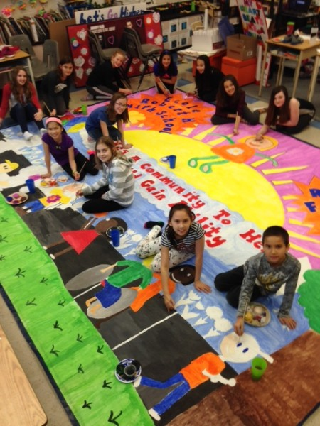 Students from Robert H Smith's Adventure Club preparing huge mural for community breakfast. /TREVOR SMITH