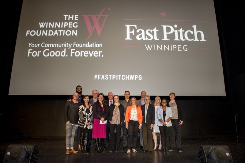 Judges (left) with Fast Pitch winners and their coaches. /DAVID LIPNOWSKI