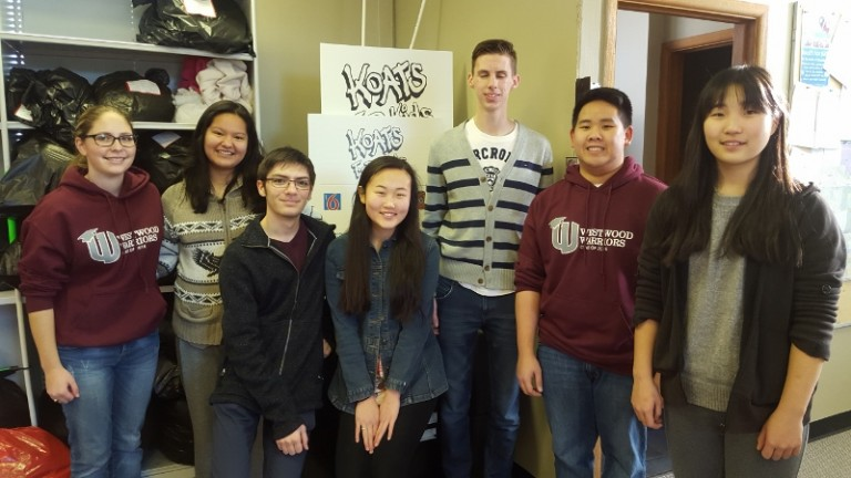 Westwood Collegiate Youth in Philanthropy students volunteering at local charity, Koats For Kids.