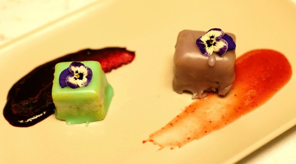 "Chef Rachel's luscious petit fours with edible pansies makes for a beautiful ending to a delicious ""Feast of Words""."