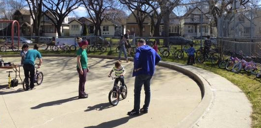 Parents and bike volunteers looked on, while the kids were testing the bikes to find the best fit. /SONJA LUNDSTROM