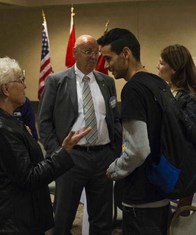 Rotary member Nancy Cosway talks to Michael Champagne about reconciliation after presentation. /jEFF SCHULTZ