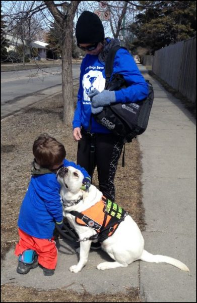Waiting for the bus; Tupper, his mom and service dog Tupper.